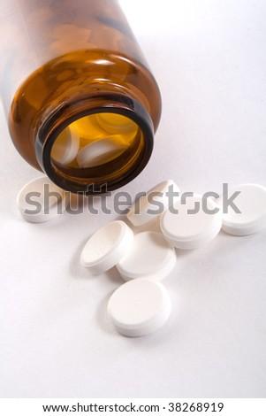 bottle with round pills