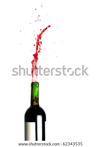Bottle with splashing red wine