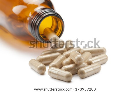 bottle with vitamin supplements on white background