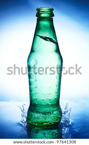 Bottle with water and splash