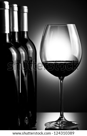 Bottles and glass of wine