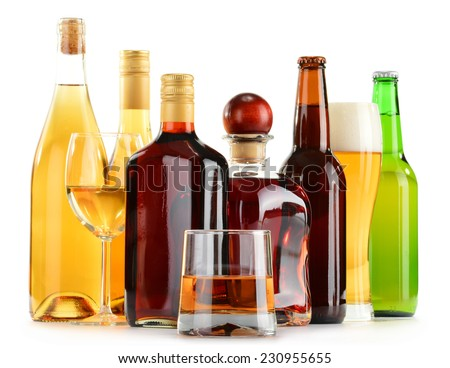 Bottles and glasses of assorted alcoholic beverages isolated on white background #230955655