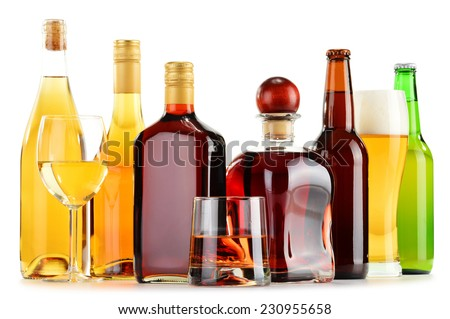 Bottles and glasses of assorted alcoholic beverages isolated on white background #230955658