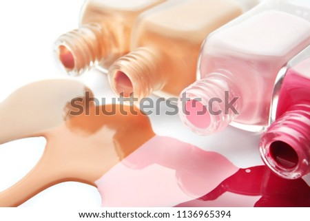 Bottles and nail polish blots on white background #1136965394