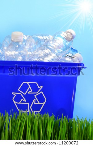 Bottles in recycling container bin in the grass