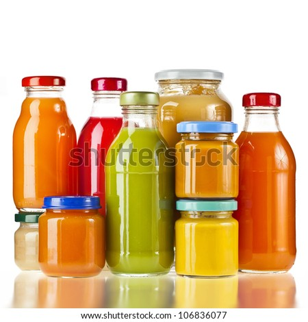 Bottles multi color glass jar juice with fresh fruit berry isolated on white - stock photo