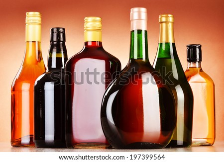 Bottles of assorted alcoholic beverages including beer and wine #197399564