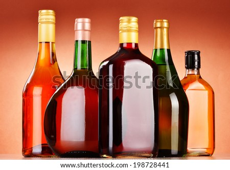 Bottles of assorted alcoholic beverages including beer and wine #198728441