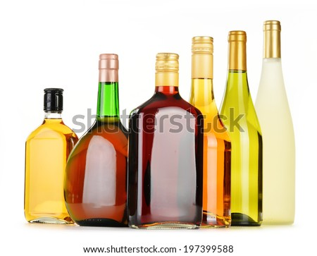 Bottles of assorted alcoholic beverages isolated on white background #197399588