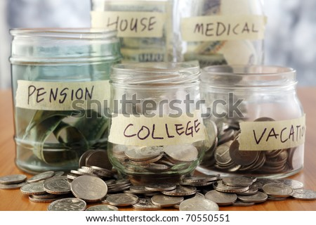 Bottles of cash with coins isolated on the background.