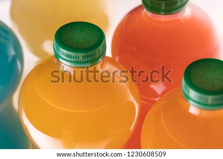 Bottles of different flavored juices, watermelon, pineapple and tropical flavor isolated on white background #1230608509