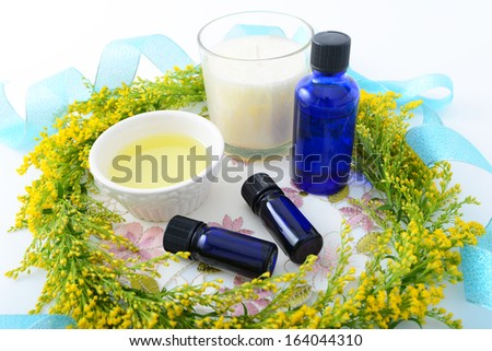 Bottles of essential oils with floral garland