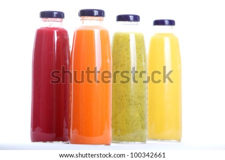 Bottles of fruit juice isolated on white background