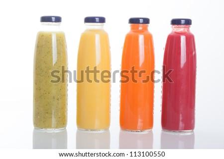 Bottles of fruit juice isolated on white background