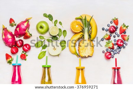 Bottles of Fruits smoothies with various ingredients on white wooden background, top view.  Superfoods and healthy lifestyle or detox  diet food concept. #376959271