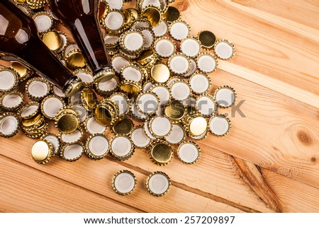 bottles  of homemade beer  and bottle caps on table