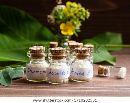 Bottles of homeopathic globules. Homeopathic medicine, jars with homeopathic sugar granules. Naturopathy, aromatherapy, homeopathy - concept Stock photo ©
