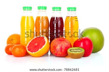 bottles of juice  with ripe fruits on white background