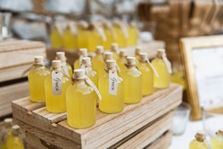 Bottles of limoncello on wooden stands. Closed with corks. Inscriptions in Italian