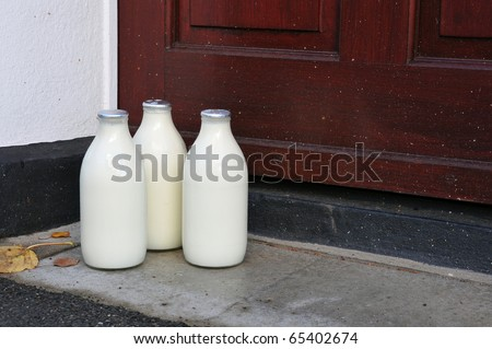 Bottles of Milk on a Doorstep - stock photo