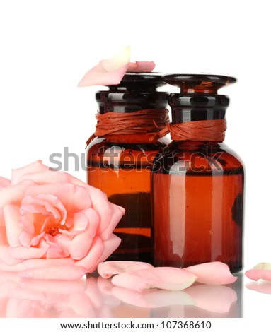 bottles of oil and rose isolated on white