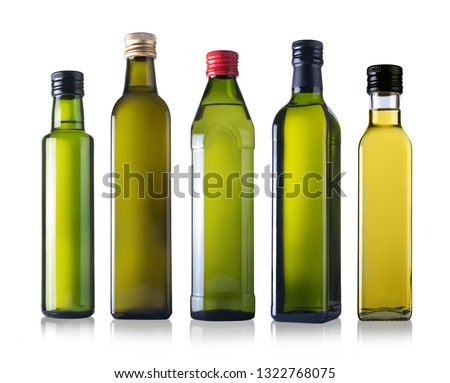 Bottles of oil isolated on a white background #1322768075