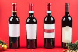 Bottles of red and white wine on a dark Burgundy background close-up. Alcohol for new year mood and holiday. New year and Christmas