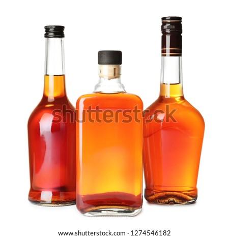 Bottles of scotch whiskey on white background #1274546182