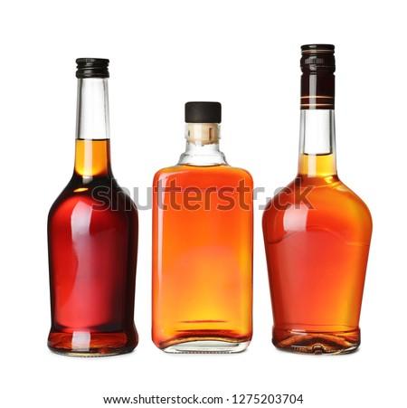 Bottles of scotch whiskey on white background #1275203704