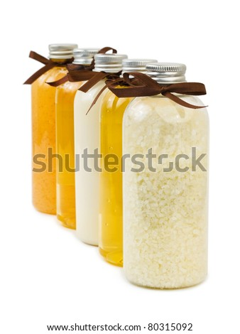 Bottles of spa oil and salt isolated on white background