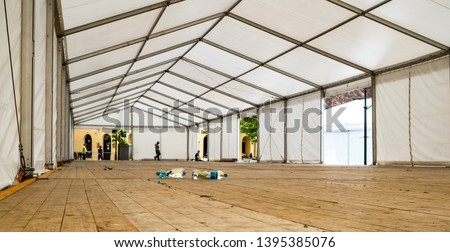 bottles of water Inside Big Canvas Tent #1395385076
