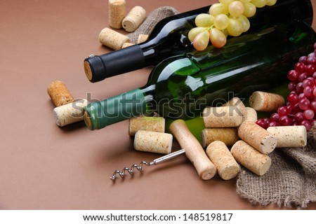 Bottles of wine, grapes and corks on brown background #148519817