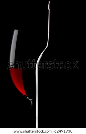Bottles of wine on black background - stock photo