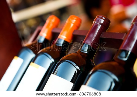 Shutterstock Bottles of wine shot with limited depth of field.