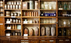 Bottles on the shelf in old pharmacy