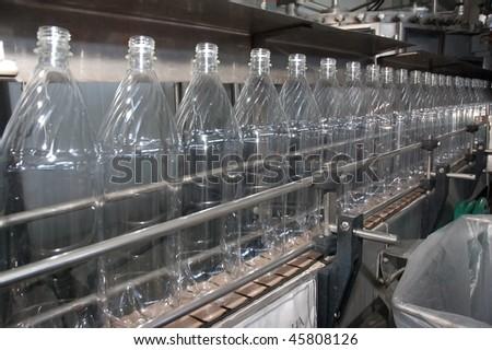 Bottles plastic The Technological line on bottling drink in plastic bottles. Conveyor automatic