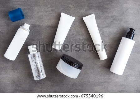 Bottles, tubes and jars with natural skincare beauty products from above. #675540196
