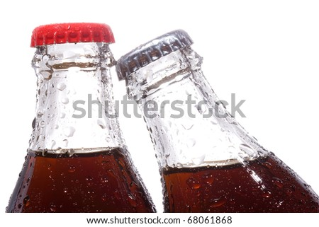 bottles with cola on white background