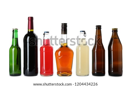 Bottles with different alcoholic drinks on white background #1204434226