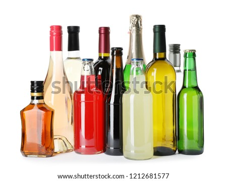 Bottles with different alcoholic drinks on white background #1212681577