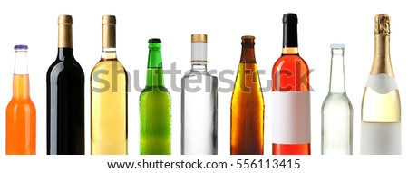 Bottles with different drinks on white background #556113415