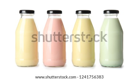 Stock Photo Bottles with different smoothies on white background