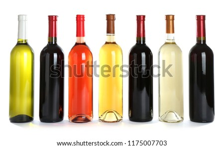 Bottles with different wine on white background #1175007703