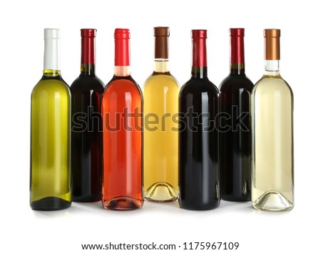 Bottles with different wine on white background #1175967109