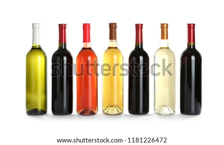 Bottles with different wine on white background #1181226472