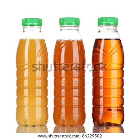 Bottles with juice isolated on white - stock photo