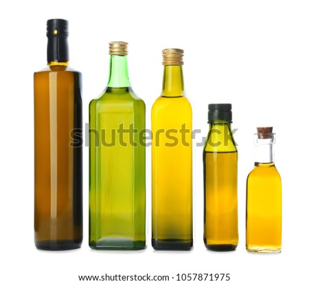 Bottles with olive oil on white background #1057871975