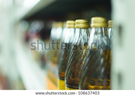 Bottles with soda drinks in supermarket