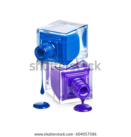 Bottles with spilled nail polish isolated on white background #604057586