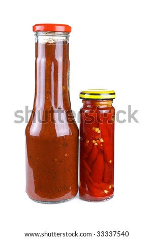 Bottles with tomato ketchup and marinated red hot chili peppers isolated on the white background